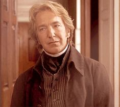 Rickman as Col brandon in sense and sensibility smiling slightly and you can tell he's completely undone in side