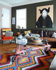 There are rugs that have the power of turning mix and match rooms into cohesive alcoves. Apartment Therapy has compiled a gallery with 10 great examples. This is one of them. You can check the rest here  http://www.apartmenttherapy.com/lebowski-style-10-rugs-that-really-tie-the-room-together-apartment-therapys-home-remedies-201715