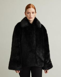 Chatel is a heavy and luxurious black faux fur jacket, with a voluminous body and flared sleeves. This piece features a big collar, hook and eye fastening at front, and pockets on both sides. Black Faux Fur Jacket, Designing Women, Fitness Models, Fur Coat, Apothecary, Sleeves, Jackets, How To Wear, Eye
