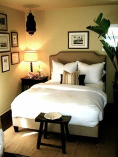 This is a great use/example of how to make a smaller bedroom feel like a cozy nook, without sacrificing style...