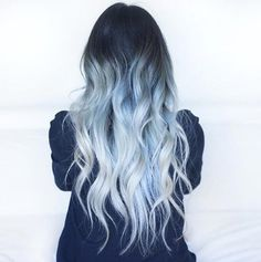 Looking for a surprising new hair color that's fit for any season? From blue pastel hair to cool shades of aqua, you'll love these light blue hair color ideas. Pelo Color Azul, Hair Color Blue, Light Blue Ombre Hair, Pastel Blue Hair, Black Hair Blue Tint, Blue Tinted Hair, Dark Hair With Color, Dark Hair Colours, Ombre Hair
