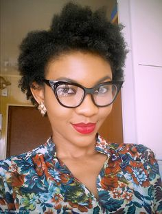 Nigerian style blogger modavracha in a freyrs clear glasses.
