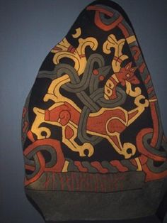 "This colourful ""lion and snake"" scene is from a reproduction of Gormsson's rune stone, painted in the bright colours that would have featured on the original.  http://hubpages.com/education/The-Runic-Ringerike-Tombstone-of-St-Pauls#"