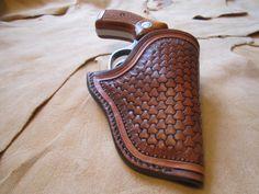 Custom Hand Carved Leather Small Revolver Holster. $70.00, via Etsy.