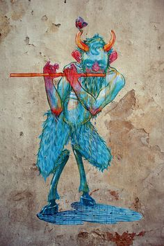 """By Dimitris Taxis : little pan playing his favourite middle finger melody Athens Greece """"the aim of every artist is to arrest motion…"""" -Faulkner"""