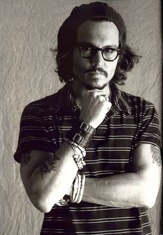"""Johnny Depp photographed for publicity for """"Corpse Bride"""" September 12th, 2005. Male actor, steaming hot, sexy guy, glasses, long hair, hands, intense eyes, arms, fingers, thoughtful, love his style, portrait, photo b/w."""