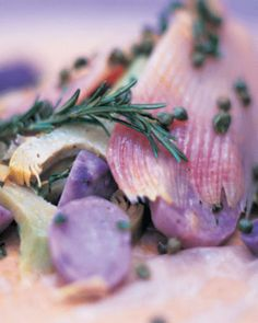 skate baked in the bag with artichokes, purple potatoes, capers and creme fraiche