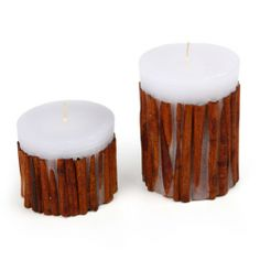 Paraffin candle with a decoration of real cinnamon sticks. Made by Neo-Spiro. #cinnamon #white #natural