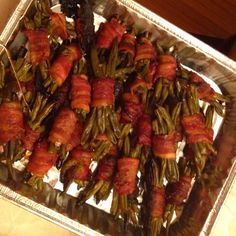 1 cup brown sugar 1/2 teaspoon soy sauce 1 teaspoon garlic salt  1 cup butter 2 bags frozen whole green beans  1 pkg bacon each strip cut in half  Take 6-8 green beans and wrap in the. 1/2 slice bacon place on foiled lined baking sheet  Heat remaining ingredients pour over bundles and place in 350 degree oven till browned approx 30 min