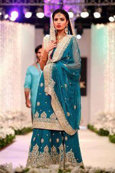 Blue and gold. Pakistani bride. Pakistan bridal fashion couture. South Asian desi wedding bride.