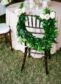 Chair Garland - See more of the wedding here: http://www.StyleMePretty.com/2014/04/14/elegant-tennessee-plantation-wedding/ Photography: AustinGros.com on #smp