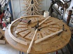 Amish wheelwright handmade wagon wheels, spokes, hubs and wheel parts Woodworking Table Saw, Woodworking Supplies, Woodworking Jigs, Woodworking Projects, Wooden Wagon Wheels, Wooden Wheel, Wood Jig, Wood Display Stand, Wood Ornaments