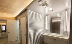 Office restroom, fixtures by a·light. Bathroom Lighting Design, Cove Lighting, Ski Chalet, Office Lighting, Commercial Interiors, Blinds, Vanity, Curtains, Group