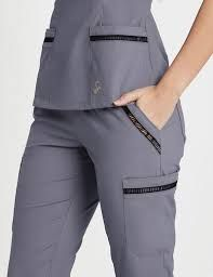 Modern Scrubs and Lab Coats for Men and Women by Jaanuu Cute Nursing Scrubs, Cute Scrubs, Nursing Clothes, Scrubs Outfit, Scrubs Uniform, Scrubs Pattern, Stylish Scrubs, Medical Uniforms, Medical Scrubs
