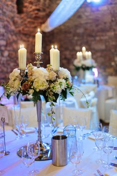 Tables were decorated with a combination of high and low table designs, our beautiful Baroque Candelabras provided the high table design option