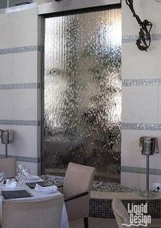 The modern wall waterfall is the best way to improve the pure magnificence of your room surroundings. For modern rooms, the best choice is metal glass waterfall since they appear to match the modern appearance of a place. Indoor Waterfall Wall, Indoor Waterfall Fountain, Water Wall Fountain, Indoor Wall Fountains, Diy Waterfall, Glass Waterfall, Tabletop Water Fountain, Waterfall Design, Indoor Fountain