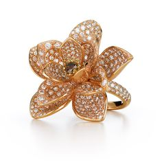 Large flower diamond ring from Kwiat's Lotus Collection in 18K rose gold In the shape of a lotus flower in bloom, the limited edition cocktail ring features brilliant diamonds in stunning in vibrant rose gold. Style No. 17689