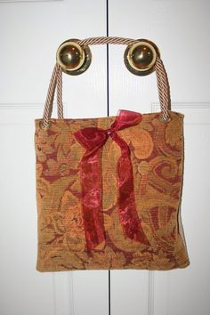These bags are all made from upholstery samples with drapery cord as handles. They look like this. They only take a few minutes to make and they are very handy and not to mention attractive. This bag is embellished with a flower made from a strip of upholstery fabric. I have used ribbons and silk … Continue reading Bags from drapery and upholstery samples. →