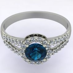 7/8ctw London Blue Topaz Halo Engagement ring in 14k White gold for under $750!   This ring features a center gemstone surrounded by a halo of 14 diamonds and a split shank with 12 diamonds on each side in a micro pave setting. In this exquisite halo ring, the center gemstone can be of your choice and the halo and shank gemstones will be white or black diamonds, based on your selection.  The center stone is 1/2 carat.