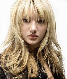 cortes-de-pelo-2014-pelo-largo-flequillo-abierto-capeado