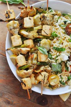 These vegan spring lemon veggie and tofu skewers are served with orzo pasta salad tossed with lemon, tomatoes and herbs. It is so amazing!