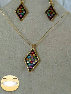 Şenay K. Baykara made these pendant and earrings  from Turkey