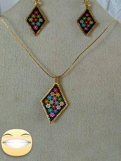 Şenay K. Baykara made these pendant and earrings  from Turkey