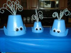 Nautical or Ocean theme party ~ 'Pod of Whales' decor made using terra cotta pots, chennille sticks, wiggly eyes, foam and a hot glue gun... too cute!