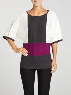 Perfect for work, this sweater is sure to keep you comfortable while still looking stylish. Featuring a 3/4 dolman sleeve, a crew neck, colour blocking and a ribbed bottom band, this pullover sweater is a Fall staple. Pull-on style. Made in...3030339-0688