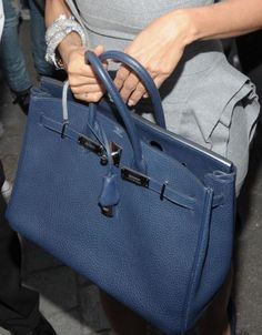 No bag is more iconic than Hermes' Kelly or Birkin bag regularly seen dangling daintily from the wrists of every real and pretending-to-be-real celebrity from O. Hermes Birkin, Hermes Bags, Christian Audigier, Kelly Bag, Grace Kelly, Chloe, Versace Handbags, Blue Handbags, Leather Handbags