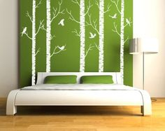 Large wall art like this is easy to duplicate with paint, tape and stencils on butcher paper, rather than directly on the wall. Use wood planks if you want dimension.