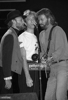 Maurice Gibb Robin Gibb and Barry Gibb of the Bee Gees perform in concert circa 1991 in New York City