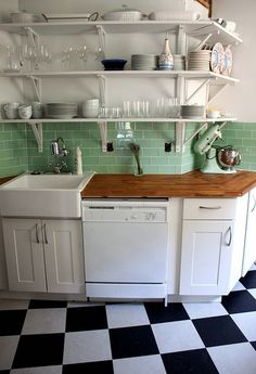 marmoleum checkerboard floor + green subway tiles + white cabinets = heaven!