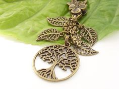 Tree of life motifs are always popular. This one is combined with filigree leaf charms in shabby chic vintage style bronze tone. The filigree leaves are quite delicate, and they reflect the swirling branches of the round tree of life charm. Vintage Style, Vintage Fashion, Blue Forest, Tree Of Life, Shabby Chic, Delicate, Bronze, Leaves, Charmed