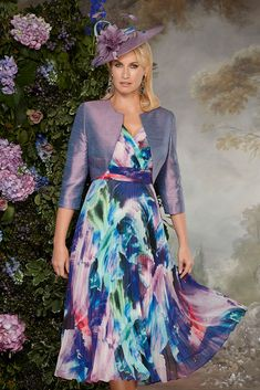 11286 (Condici) A pleated print chiffon dress with silk bolero in Pizzazz and Lilac Shimmer. The dress has a pleated crossover with a
