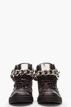 GIUSEPPE ZANOTTI //  Black Leather Croc-Embossed Chain-Strap Sneakers  32266M050019  High top leather sneakers in black with embossed croc print throughout. Silver tone hardware. Black lace up closure. Tonal leather logo patch at tongue. Signature zip closures at eyerow and heel. Large curb link chain strap with pin buckle closure. Tonal rubber foxing. Tonal stitching. Leather upper, rubber sole. Made in Italy.  $1175 CAD