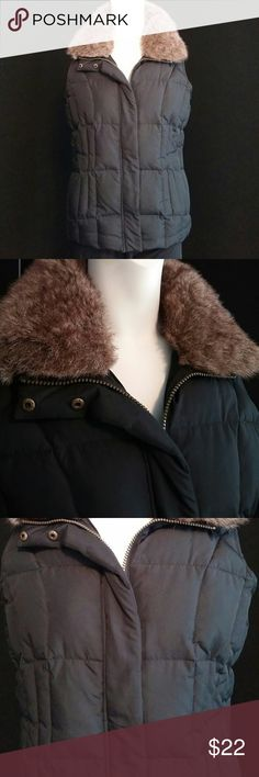 Cute down black vest Really cute down black vest with faux fur collar. Zipper and snap closures, faux fur collar in excellent shape and is removable. Ladies medium 8 to 10. Length from the shoulder to the bottom is 24 in. Armpit to armpit is 20 in across. Is vest is in really nice shape. Athletic Works Jackets & Coats