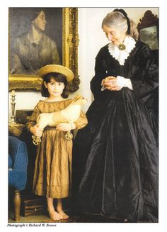 Antique photo of Tasha Tudor , illustrator, with a child holding an antique dog toy.