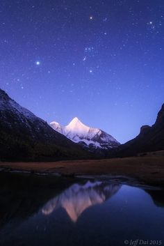 "Mount Jampayang in China at the break of dawn  Jeff: ""Starry sky at the break of dawn over Mount Jampayang. The background sky includes the bright star Sirius on the left, prominent constellation Orion in the middle and Aldebaran at the top right of the image. The pyramid mountain, Jampayang with an elevation of 5,958m is located at Yading National Nature Reserve, Sichuan province, China."