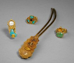 Hairpin, earring, and two rings. Mongol Yuan dynasty (1271-1368), made of gold, malachite, glass, and pearl.  Length of hairpin 4 in. (10.2 cm).  These were excavated from the Shi family tombs located in Houtaibaocun, Shijiazhuang, Hebei Province in 1994.