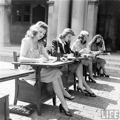 Fashion in St. Louis. Photographer Nina Leen. LIFE, 1944. Students writing notes in what may be fashion class outside Brookings Hall, the most recognizable building on the Danforth Campus, Washington University in St. Louis.