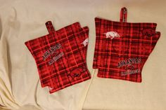 Check out this item in my Etsy shop https://www.etsy.com/listing/253680251/arkansas-razorback-hot-pad-pot-holder