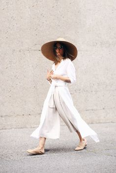 all white fashion + oversized woven sunhat.