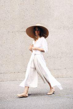 all white fashion + oversized woven sunhat.