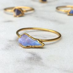 A lovely raw opal ring. The Australian Opal is the October Birthstone, and makes a lovely stacking ring. Wear these natural opals as one dainty ring or as a statement ring stack. Made by Ringcrush Raw Opal Ring, Rough Opal, Ring Verlobung, October Birth Stone, Bohemian Jewelry, Gemstone Jewelry, Australian Opal, Natural Opal, Gold