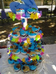 Hawaiian Beach themed cupcakes with brown sugar sand and gummy flip flops.