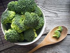 Fresh Broccoli in a bowl on rustic background