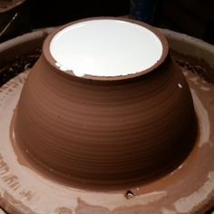 Make a plaster mold, right on the potter's wheel