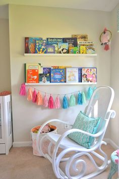 Tissue Tassel Garland adds such a fun pop of color to this library wall! Mermaid Nursery, Girl Nursery, Baby Bedroom, Kids Bedroom, Nursery Furniture, Nursery Decor, Bentwood Rocker, Library Wall, Project Nursery
