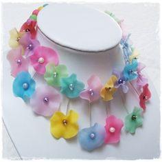Translucent polymer clay flower necklace by allchainedup.wordpress.com